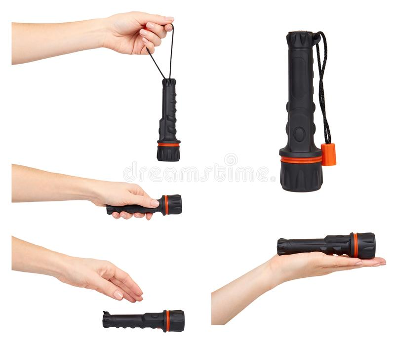 Black plastic flahslight, portable light device, set and collection. Hand with black plastic flahslight, portable light device, set and collection. Isolated on stock photos