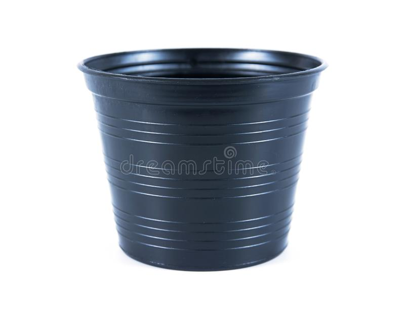 Black plastic flower pots on white background. Plastic flowerpot isolated. Background stock photos