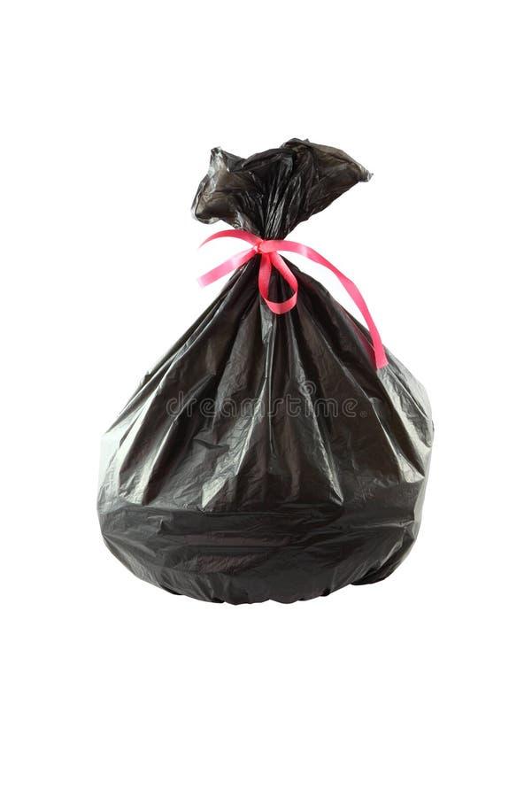 Black plastic garbage bag. On white background stock photos