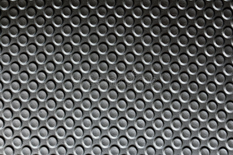 Black plastic surface with rough texture stock photo