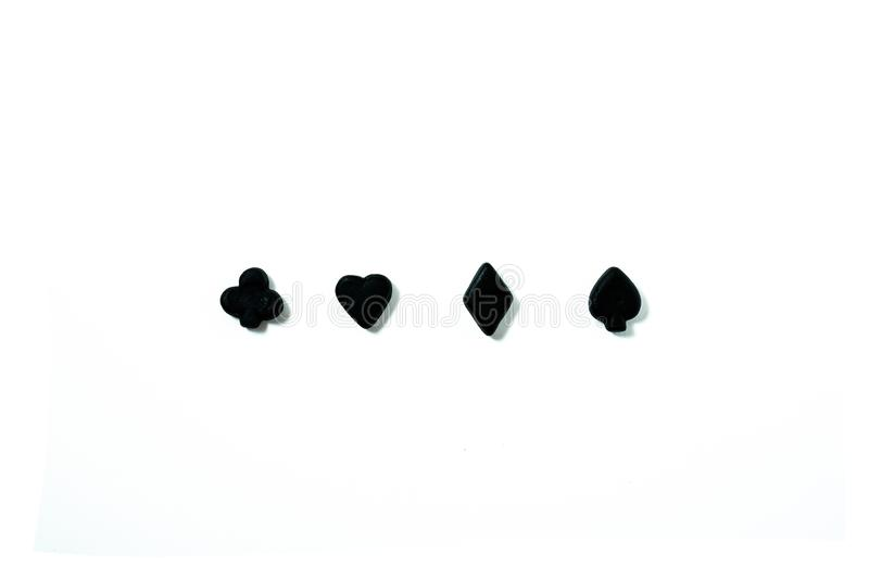 Black playing cards symbols against white background royalty free stock photography