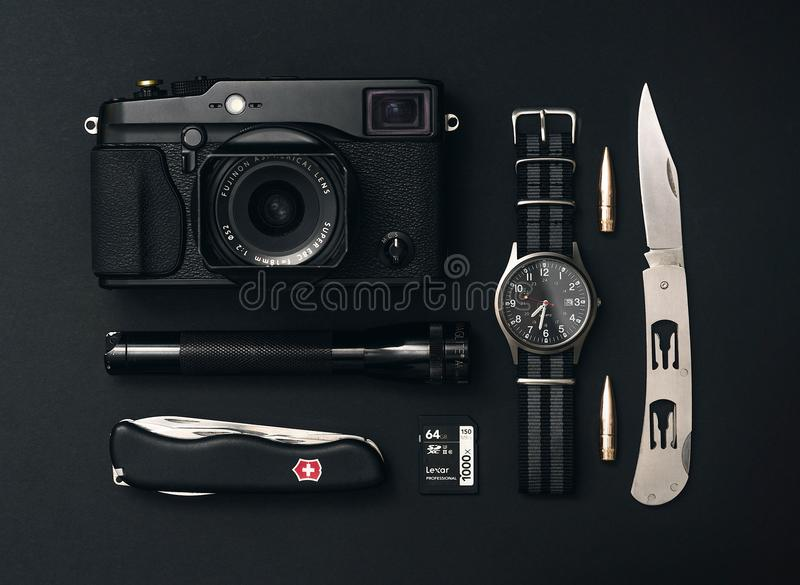 Black Point-and-shoot Camera, Analog Watch, and Flashlight royalty free stock image