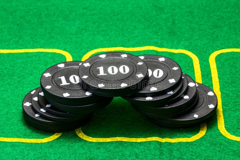 Black poker chips lined up in the shape of an arc royalty free stock photos