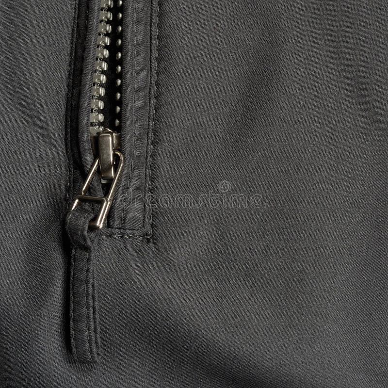 Black polyester twill fabric texture background, open jacket zip, large detailed closeup stock photos