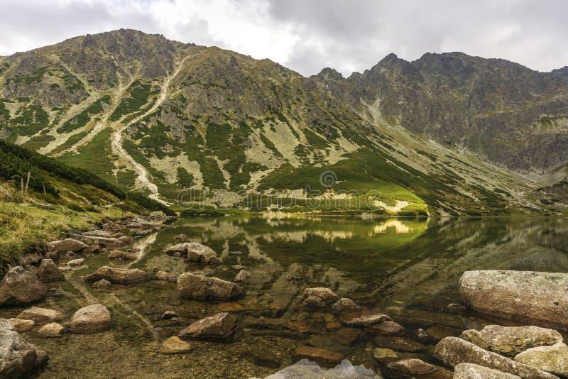 Black Pond Gasienicowy beautiful clean mountain lake. Tatra Mountains. Poland. stock photos