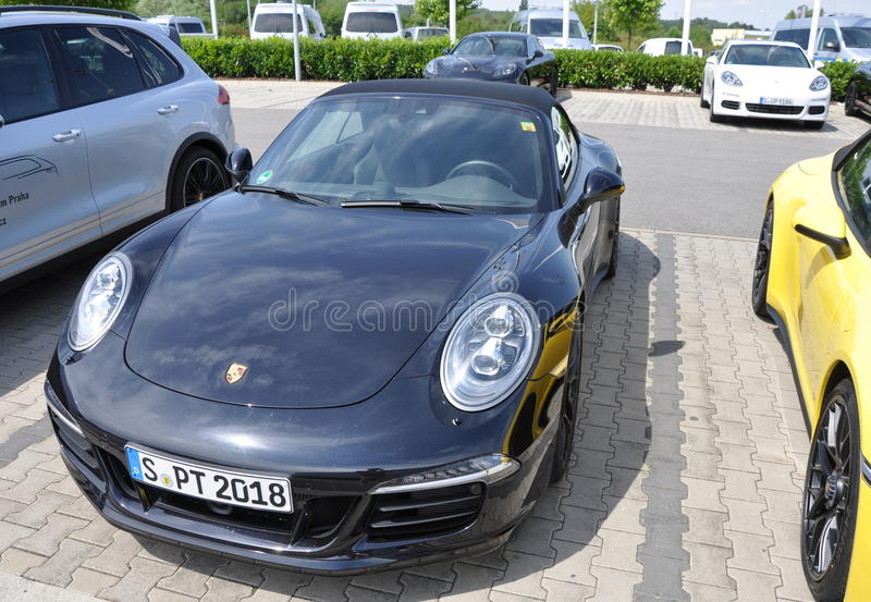 Black Porsche 911 Carrera 4 GTS royalty free stock images