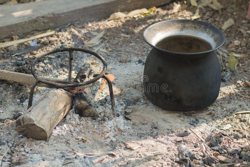 Black pot fire black pot sunrise iron boil outdoor. Black pot sunrise iron boil outdoor royalty free stock photos