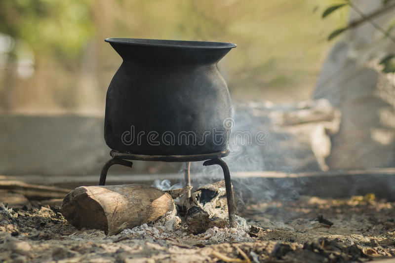Black pot sunrise iron boil. Outdoor royalty free stock images