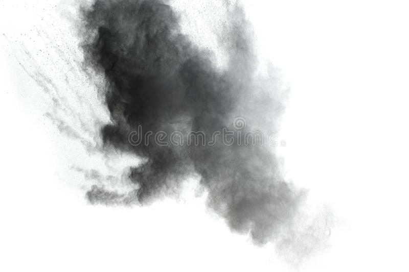 Black powder explosion. The particles of charcoal splatter on white background. Closeup of black dust particles splash isolated on background royalty free stock photos