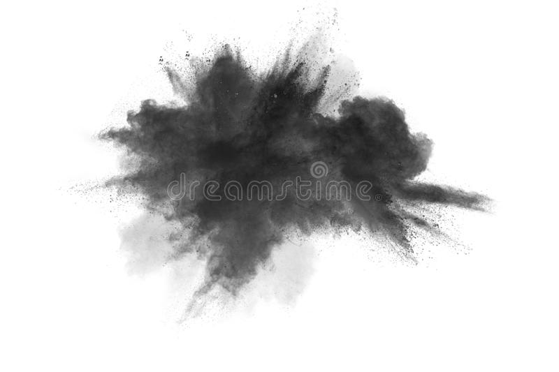 Black powder explosion. The particles of charcoal splatter on white background. Closeup of black dust particles splash isolated on. Background stock images