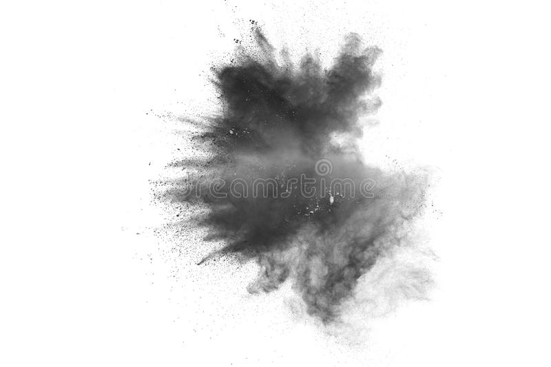 Black powder explosion. The particles of charcoal splatter on white background. Closeup of black dust particles splash isolated on. Background stock image