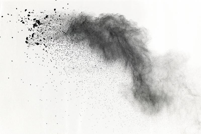 Black powder explosion on white background. Colored cloud. Colored dust explode. Paint Holi. royalty free stock image