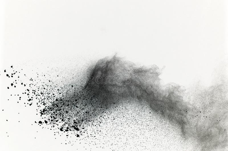 Black powder explosion on white background. Colored cloud. Color stock photography