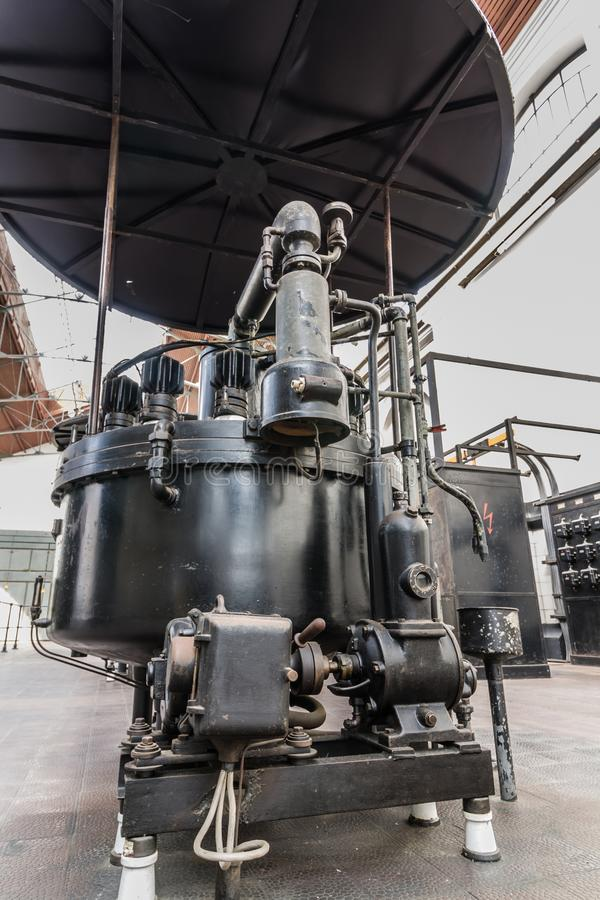 Black power transformer at old power station. Industrial part of electric substation royalty free stock photos