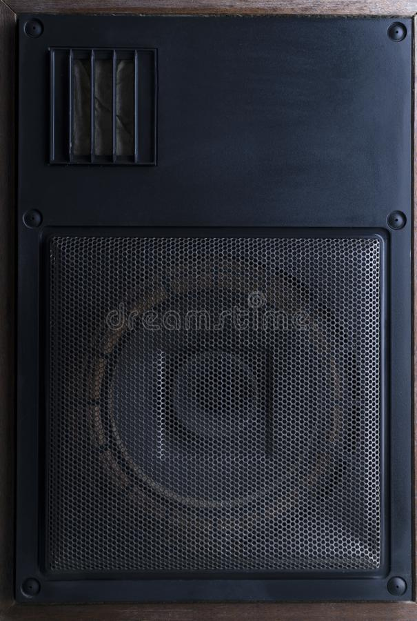 Black powerful speaker standing on the floor against vintage brick wall.Concept of recording or music studio stock image
