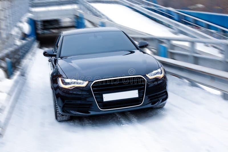 Black prestigious car on snow royalty free stock photos