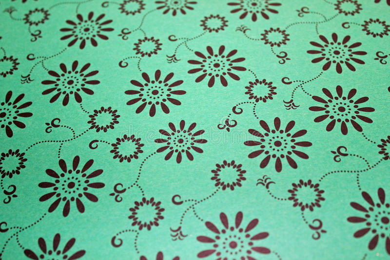 Black Print Pattern. This photo shows black floral circles on a green background royalty free stock image