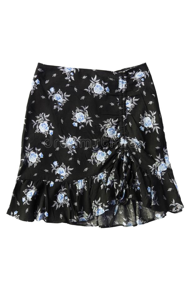 Mini skirt isolated. Black printed mini skirt with ruches isolated over white royalty free stock image