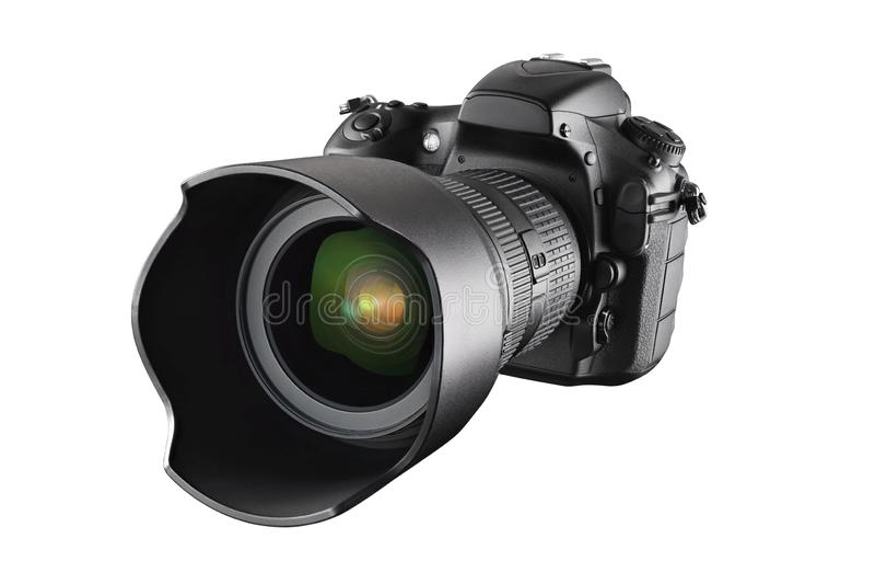 Black professional DSLR camera isolated. Black professional DSLR camera with zoom lens isolated on white background royalty free stock photo