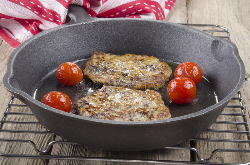 Black pudding boxty in a pan stock image