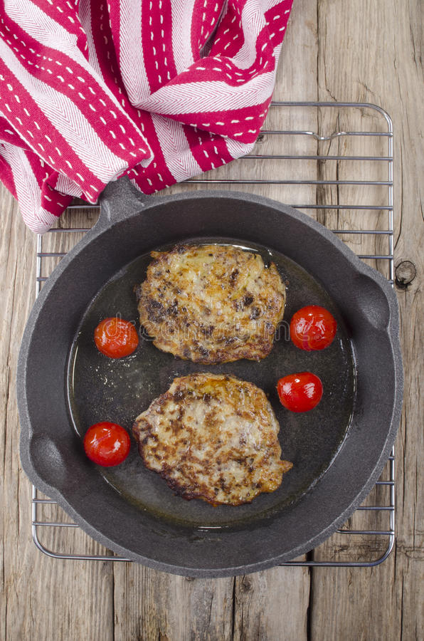 Black pudding boxty in a pan stock photography
