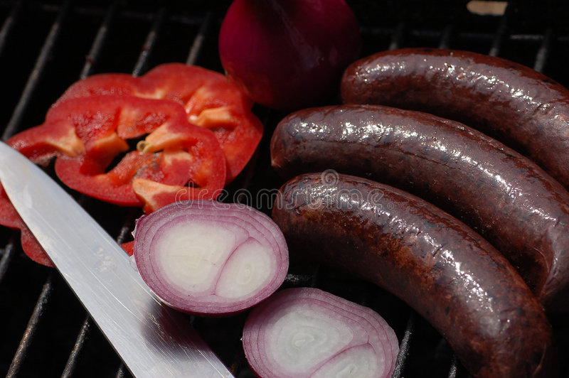 Black pudding with onion and pepper royalty free stock images