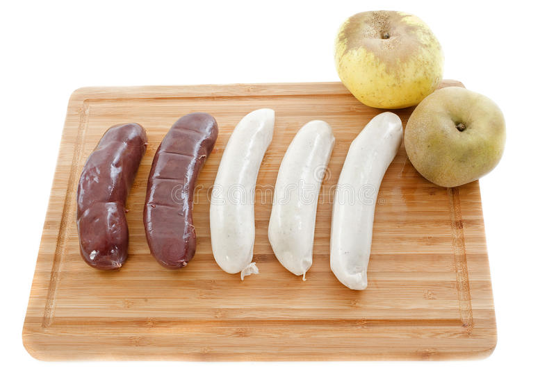 Black pudding and white sausages. Black pudding sausages and white sausage, boudin, on a cutting board stock photo