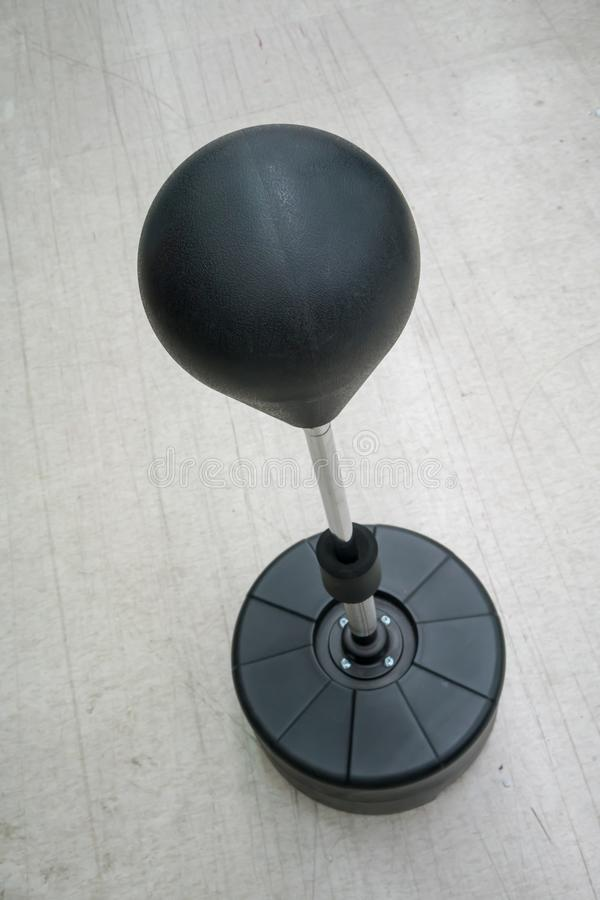 Black punch ball on adjustable stand with spring structure for r stock image