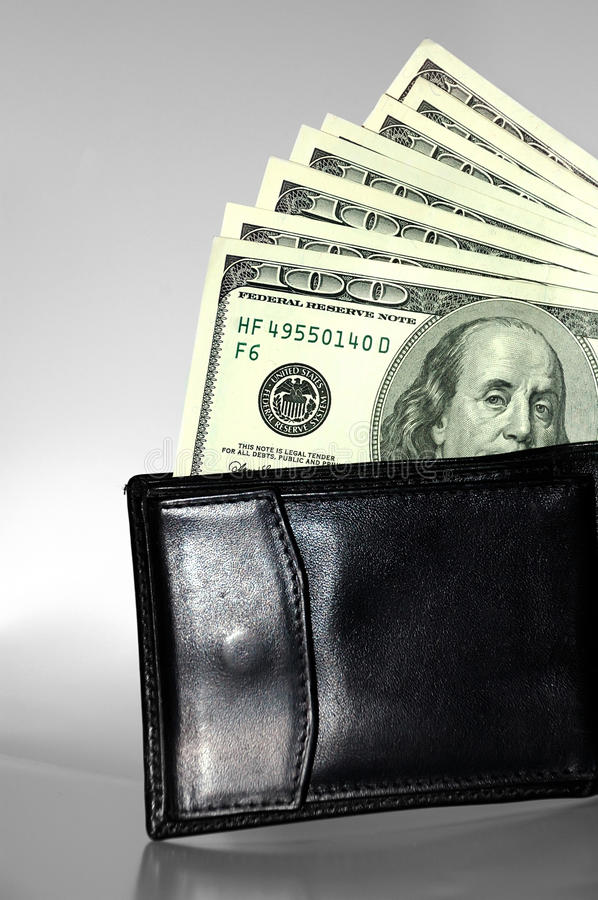 Black Purse With Dollars Stock Photo