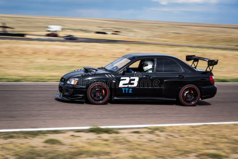 Race car on racetrack stock photos