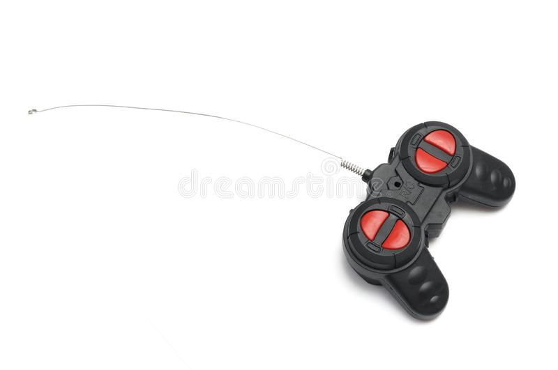 A black radio control RC remote controller with red buttons and a fine antenna royalty free stock photo