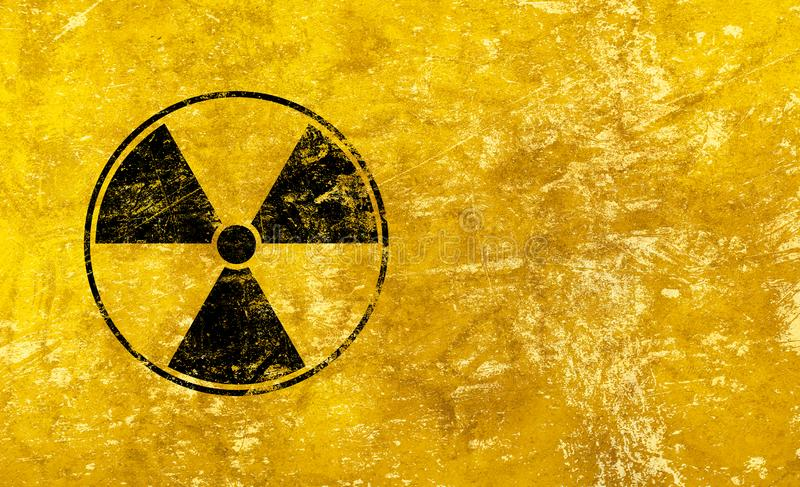Black radioactive sign over yellow background. Black radioactive hazard warning sign painted over grunge yellow background with copy space stock photos