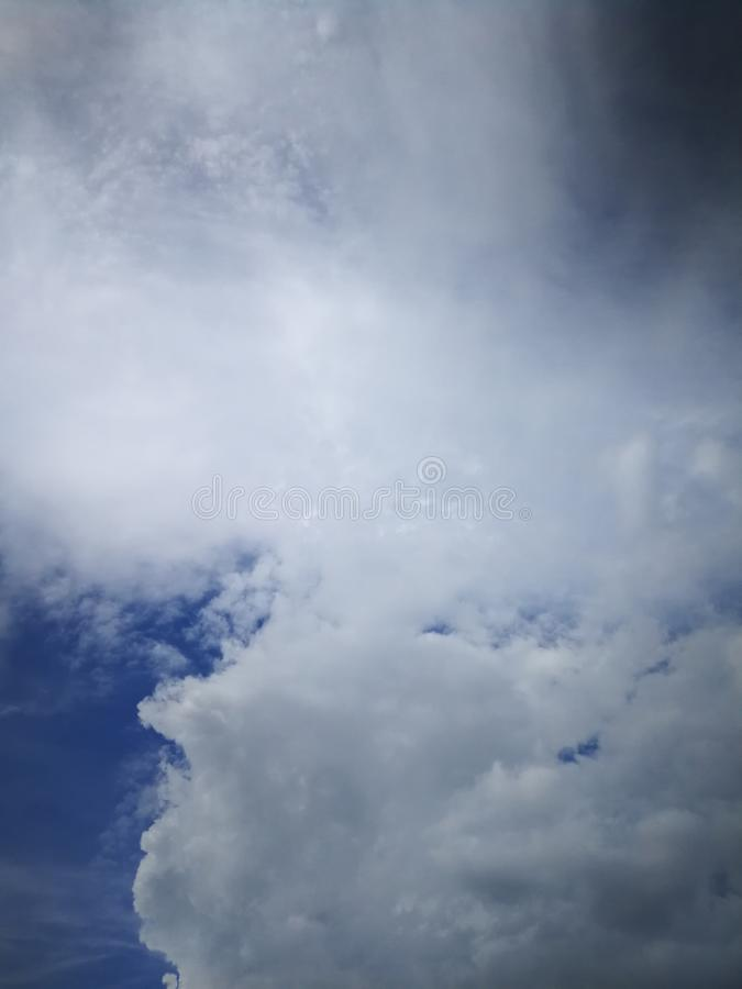 Black rain clouds in the dark blue sky stock photography