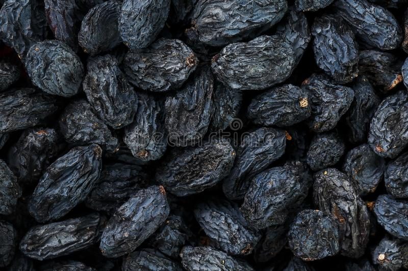 Black Raisin texture, popular dried fruit. Dried grapes. stock images