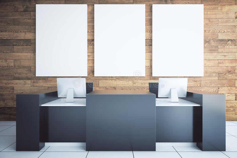 Black reception desk. Modern black reception desk with two computer monitors and blank billboard in room with wooden wall and tile floor. Mock up, 3D Rendering royalty free illustration
