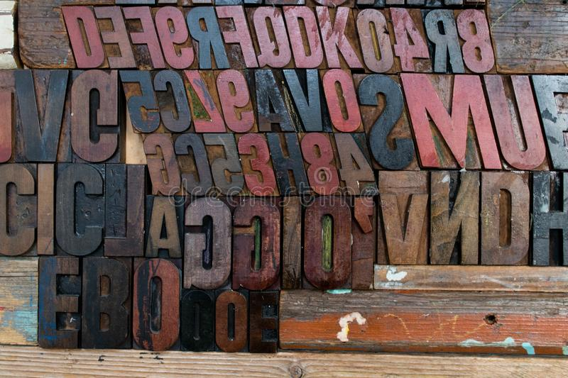 Black, red and brown fonts made of wood and embossed in a wooden royalty free stock photos