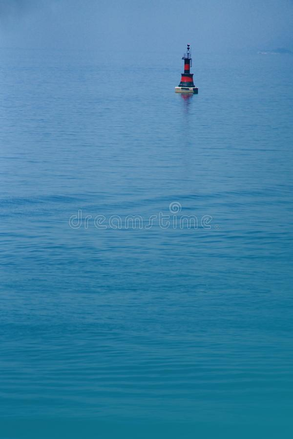 Black and red buoy on the sea. Just a black and red buoy on the ocean stock photography