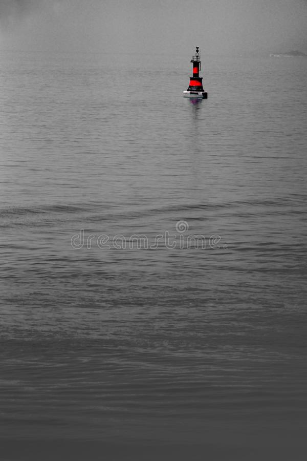 Black and red buoy on the sea. Just a black and red buoy on the ocean stock photos