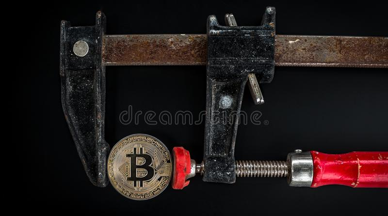 Black and Red Caliper on Gold-colored Bitcoin stock image