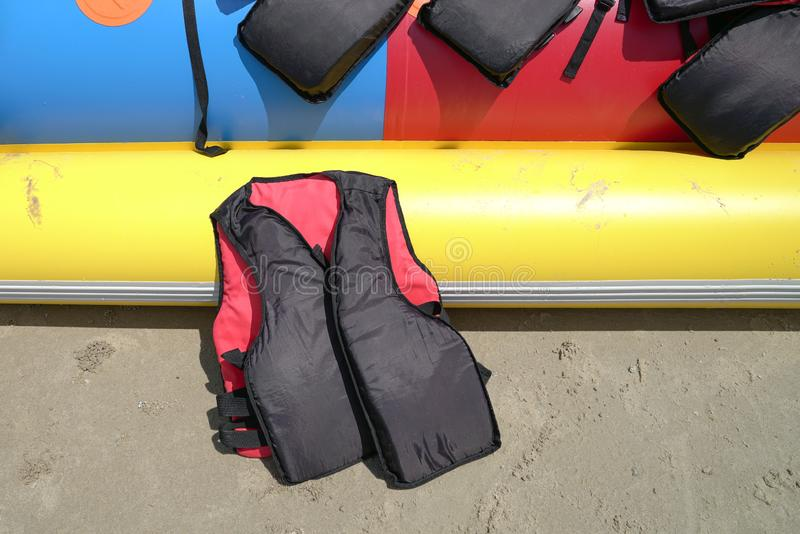 Black and red color life jacket royalty free stock photo