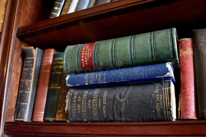 Black, Red, Green, and Blue Antique Books royalty free stock photo