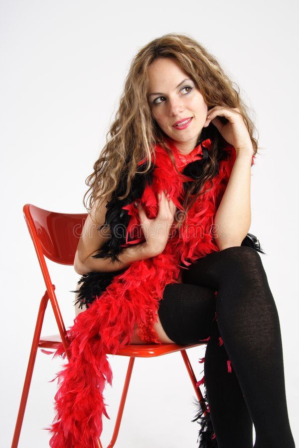 Black & Red No.2. Beautiful brunette woman dressed with black underwear and a red feather boa royalty free stock photo