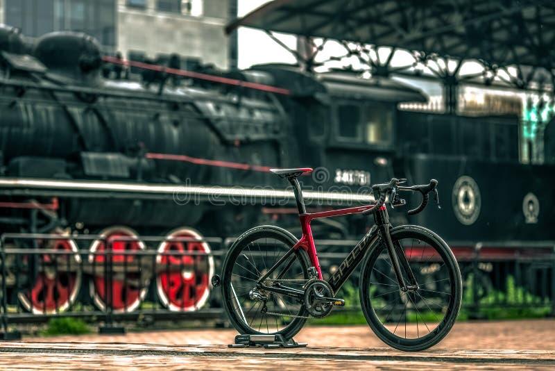 Black And Red Road Bike Near Black Train stock photos