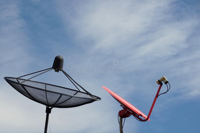 Black and red satellite dish with the blue sky stock images