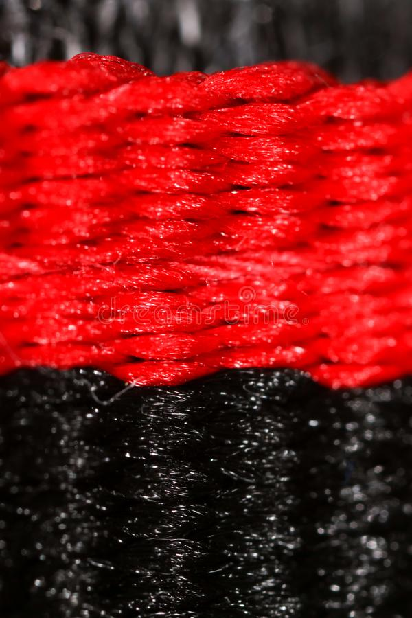 Black and red thread on fabric stock photography