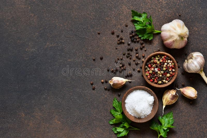 Black, red and white peppersalt, salt, garlic in a wooden bowl . Classic spices for cooking. View from above royalty free stock images