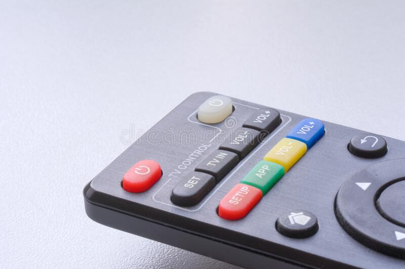Black remote control on white background closeup with copyspace.  stock images