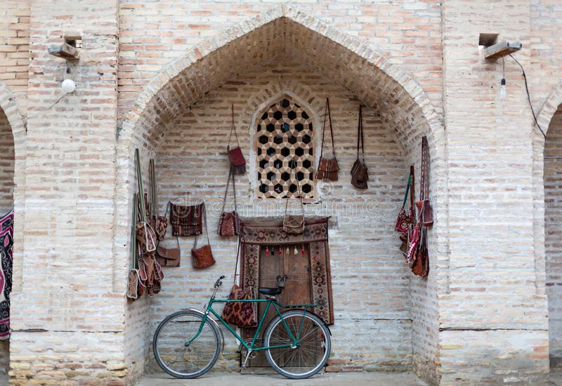 Black retro vintage bicycle with old brick wall and copy space. Retro bicycle with basket in front of the old brick wall stock photos