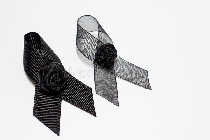 Black ribbon; decoration black ribbon hand made artistic design for sadness expression isolated on white background.  stock images