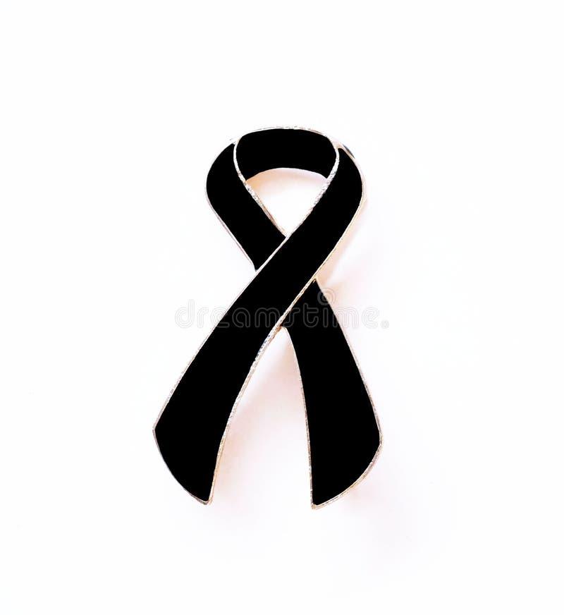 Black ribbon mourning and melanoma awareness. royalty free stock photography